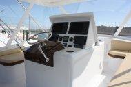 ...varnished teak seat fiddles and helm pod in the bridge...